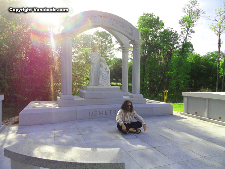 Vanabode author Jason Odom posing meditation style in Oak Lawn Cemetary