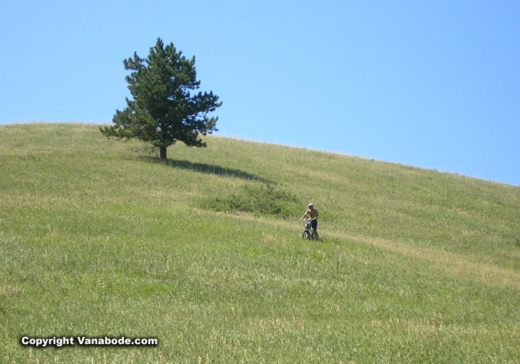 Picture of Jason riding down a large hill